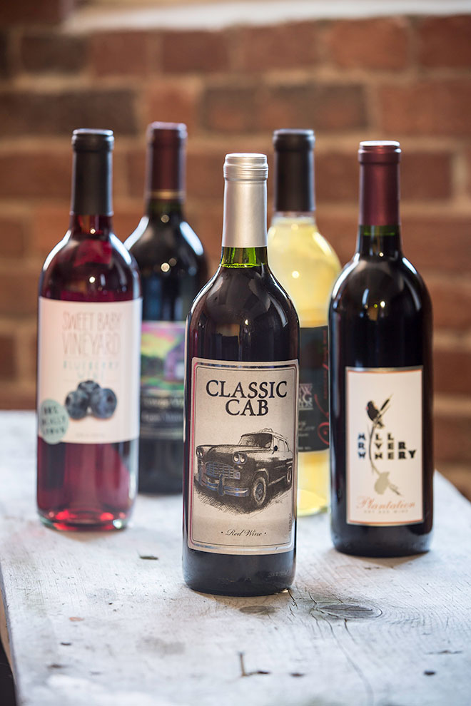 classic cab, mill river, and other local wine bottles.
